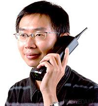 Chinese Man Talking On His Motorola Dynatec 8000x